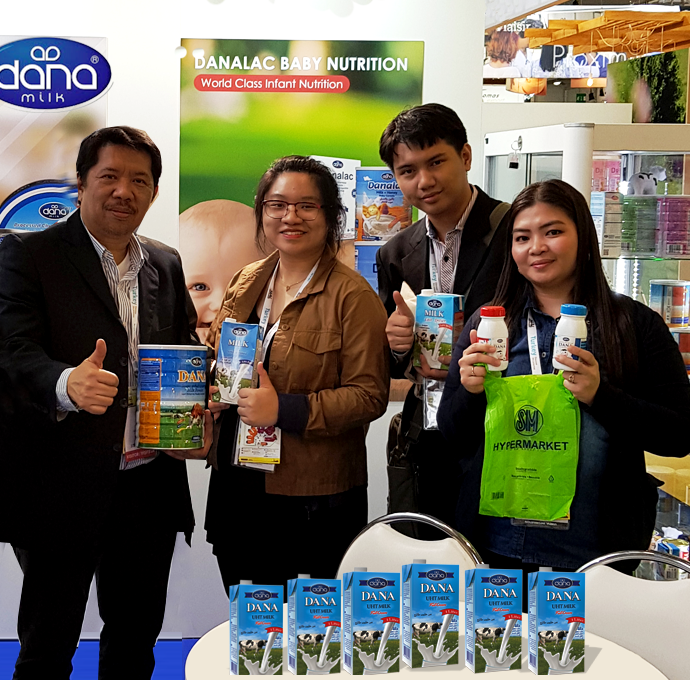 "Mr. Oroza and the team from Foodsecrets at SIAL show with DANA products. The company is a major distributor of DANA Dairy to well-known retail chain ""SM"" Supermarkets/Hypermarkets in the Philippines"