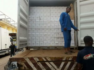 The man who will take the cartons of milk down and get them ready to be delivered to the shops in Guinea Conakry