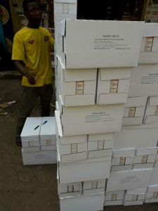 White cartons of UHT tetrapaks arrive in time for delivery they rest for a short while in Guinea Conakry here but it won't be long they go fast